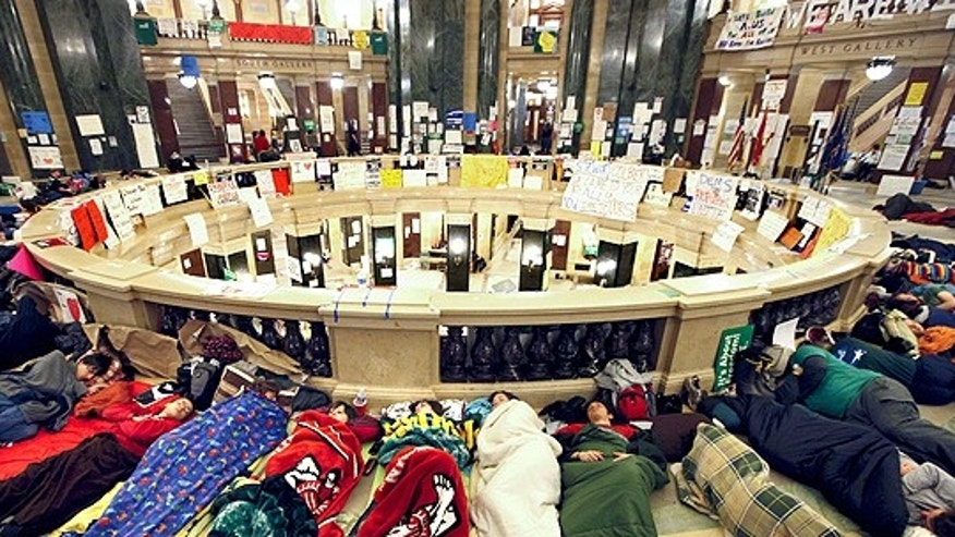 Feb. 22: Opponents of Wisconsin Governor Scott Walker's budget bill sleep in the rotunda of the Wisconsin State Capitol.