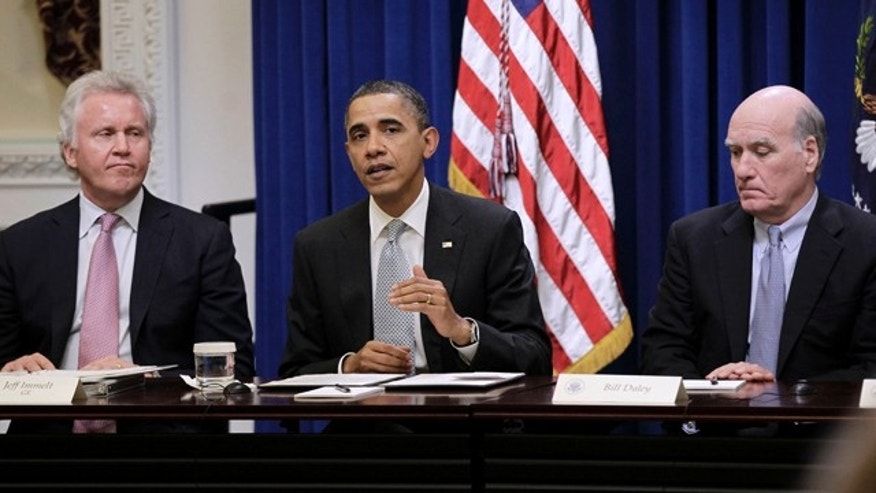 In this file photo, President Obama is shown with GE Chairman Jeffrey Immelt, left, and White House Chief of Staff, Bill Daley, during his meeting with his Council on Jobs and Competitiveness in Washington.