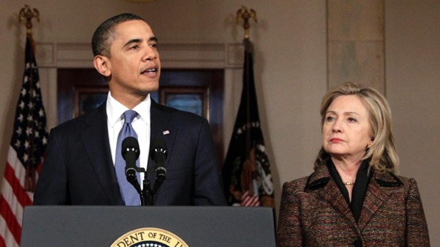 Feb. 23: Obama, with Secretary of State Hillary Rodham Clinton at right, speaks about the situation in Libya in Washington. The Obama administration could impose travel bans, freeze assets and take other steps against Qaddafi loyalists as early as Feb. 25, officials said.