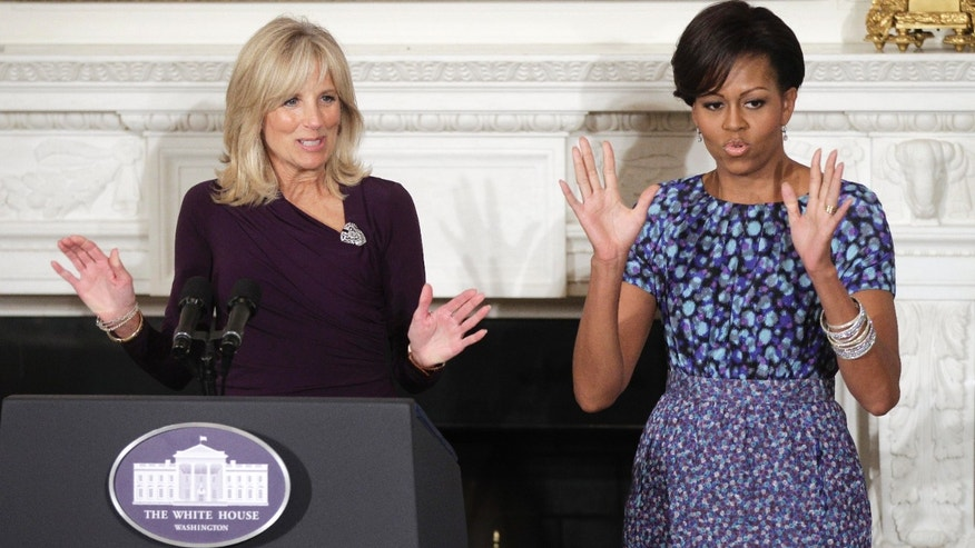 Feb. 28 Michelle Obama and Jill Biden speak during a bi-partisan meeting in Washington. Michelle Obama says a new campaign she's launching on behalf of U.S. troops and their families will encourage the public to step up to help make military families' lives a little easier.