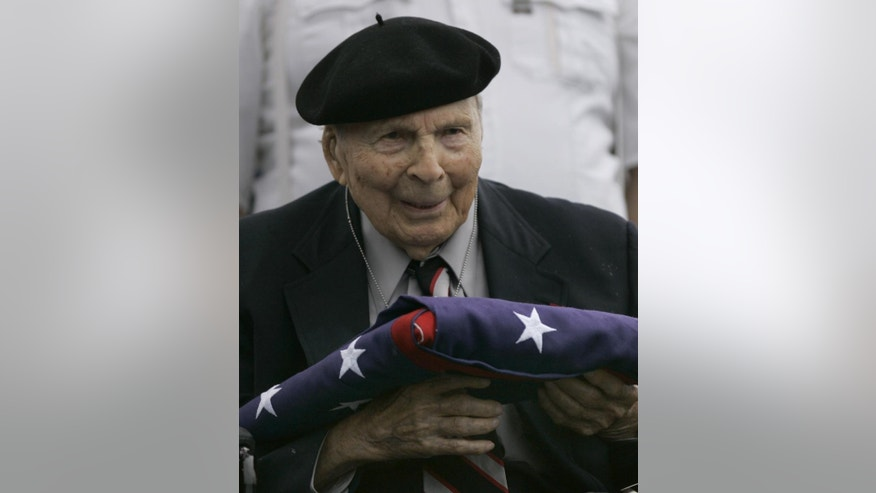 Frank Buckles receives an American flag during Memorial Day activities at the National World War I Museum in Kansas City, Mo. in May of 2008.  Buckles died early Sunday, Feb. 27, 2011 of natural causes in his home in Charles Town, W.Va. (AP Photo/Charlie Riedel)