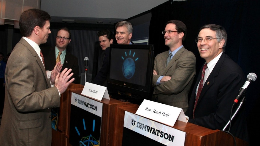 In this photo taken by Feature Photo Service for IBM: Dr. Eric Brown from IBM Research preps four members of congress - Jared Polis (D-Colo.), Bill Cassidy (R-La.), Jim Himes (D-Conn.), Rush Holt (D-N.J.) - for an exhibition game against IBM's Watson on Monday, Feb. 28, 2011. (AP)