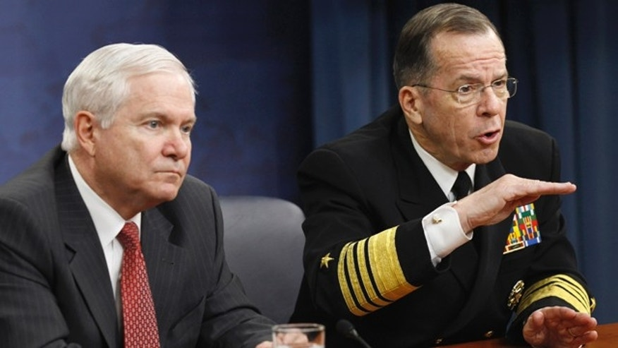 March 1, 2011: Defense Secretary Robert Gates, left, and Joint Chiefs Chairman Adm. Mike Mullen take part in a news conference at the Pentagon.