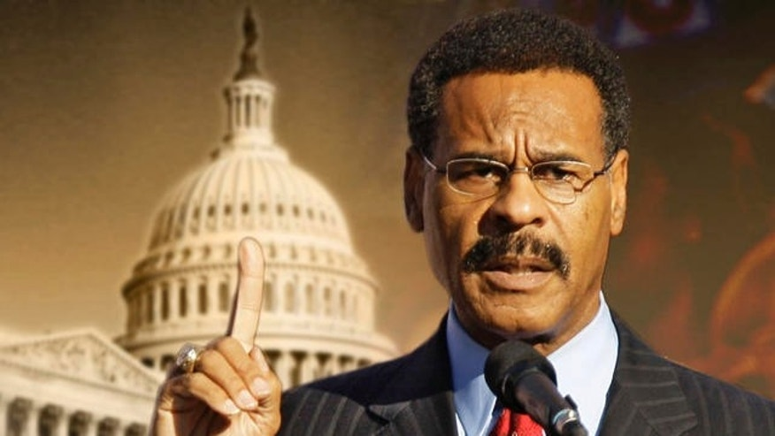 Rep. Emanuel Cleaver, D-Mo, addresses the crowd before a rally by Michelle Obama, wife of Democratic presidential candidate Sen. Barack Obama, D-Ill., in Kansas City, Mo. Wednesday, Oct. 1, 2008. (AP Photo/Charlie Riedel)