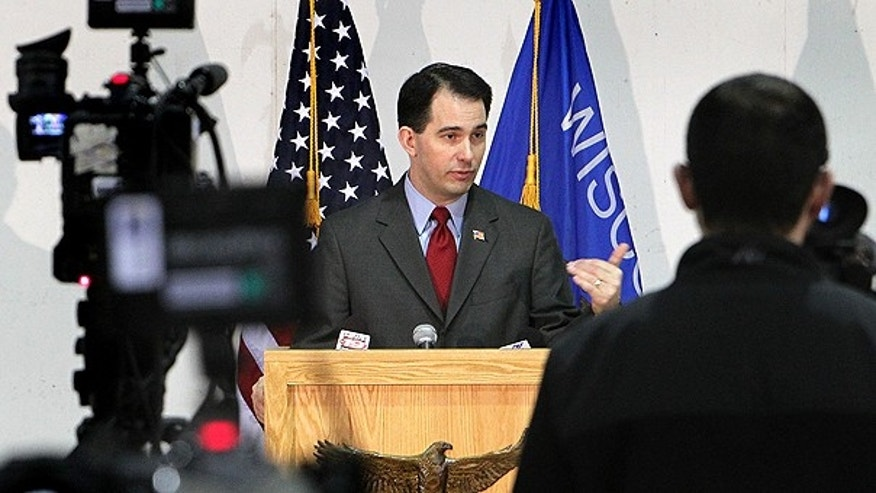 Feb. 28: Gov. Scott Walker addresses the media during a news conference at Colgan Air Services at the La Crosse Municipal Airport in La Crosse, Wis.