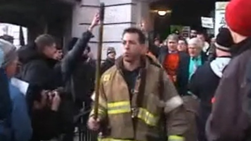 March 1, 2011: Protesters clear a path for firefighters to escort Sen. Glenn Grothman to an underground entrance to the Capitol.