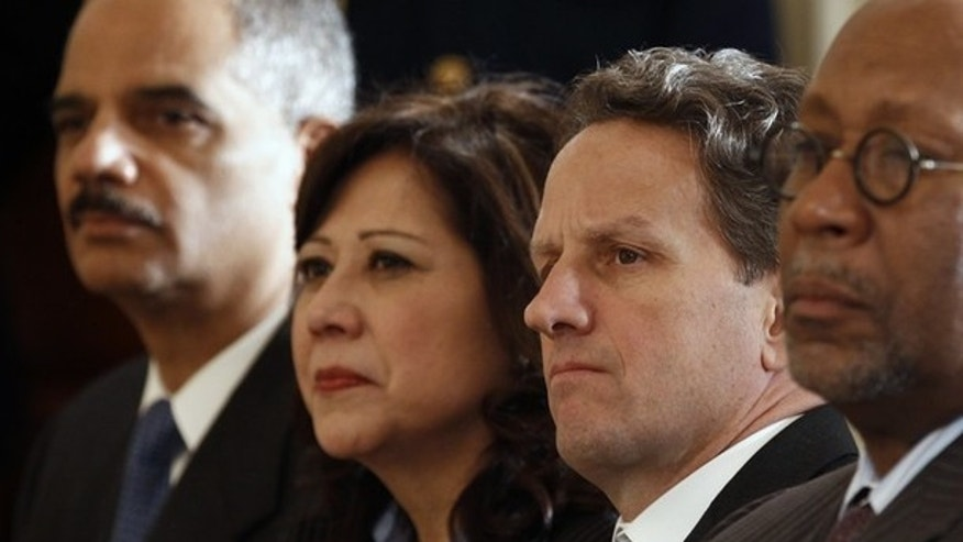 Attorney General Eric Holder, Labor Secretary Hilda Solis, Treasury Secretary Tim Geithner and U.S. Trade Representative Ron Kirk in Washington January 24, 2011.  (Reuters)