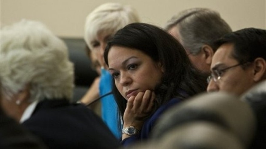 Senator Luz Robles listens during a roundtable discussion in immigration reform at the Utah State Capitol Building Tuesday, July 20, 2010 in Salt Lake City. (AP)