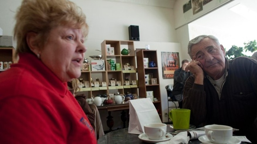 In this March 2, 2011 photo, Nancy, left, and her husband Harry Harrington talk about the Wisconsin budget crisis at Wilson's Coffee & Tea in Racine, Wis. There once was time when the Harrington's walked the picket line outside the nursing home where she was a medical aide, protesting the lack of a pension plan for the unionized work force. But those days of family solidarity are gone. Harry now blames years of union demands for an exodus of manufacturing jobs from this blue-collar city on the shore of Lake Michigan.