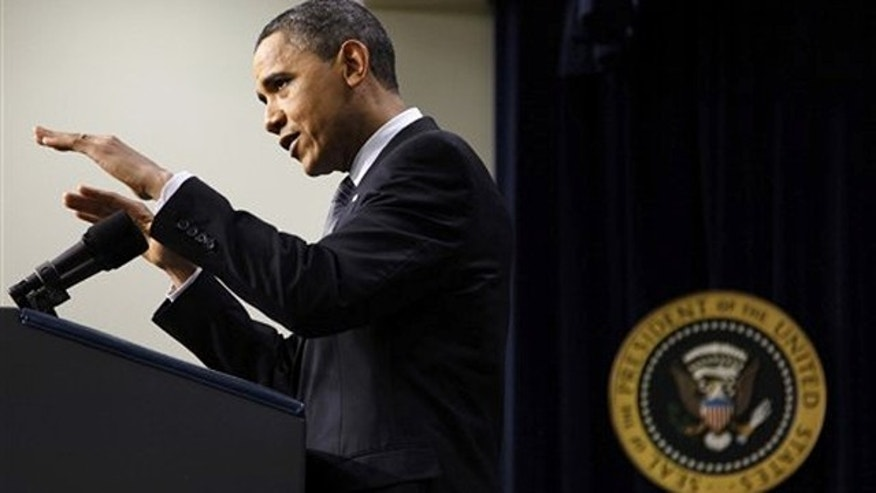 President Obama gestures during a news conference on the White House complex in Washington Feb. 15.