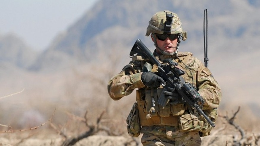 March 8, 2011: Army 1st Sgt. Raymond Dakos patrols near Combat Outpost Kowall in Kandahar, Afghanistan