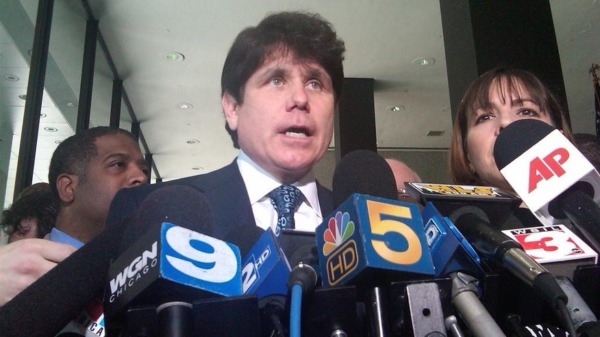 Aug. 12, 2010: Rod Blagojevich speaks to the media during a break at his trial. He was later found guilty on one of 24 counts. The jury deadlocked on the rest.
