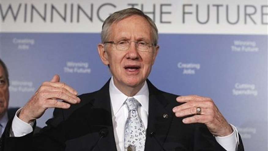 Senate Majority Leader Harry Reid gestures during a news conference on Capitol Hill Feb. 16.
