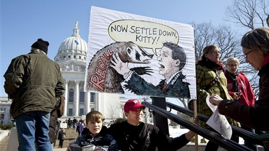 Protesters gather outside the Capitol in Madison, Wis., March 10.