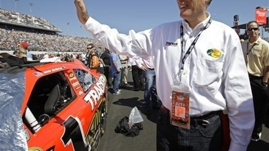 Feb. 20: Former Massachusetts Gov. Mitt Romney waves to fans before the Daytona 500 NASCAR auto race at Daytona International Speedway in Daytona Beach, Fla.