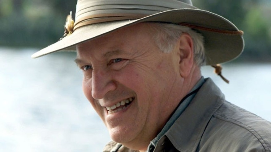 In this July 8, 2001, file photo released by The White House, Vice President Dick Cheney smiles while fly-fishing on the Snake River with his family in his home state of Wyoming.