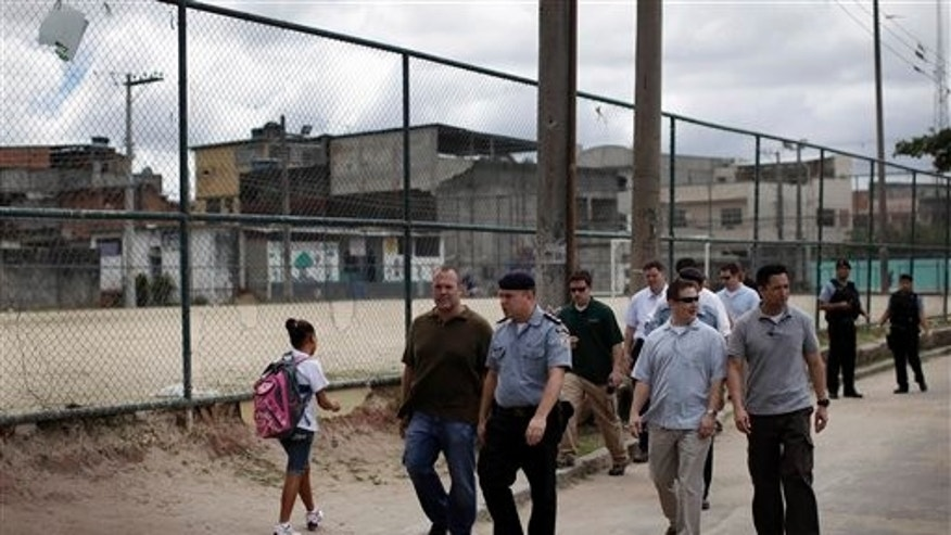 March 15: U.S. and Brazilian security officers inspect an area where President Barack Obama is expected to visit in the slum Cidade de Deus, or City of God, in Rio de Janeiro, Brazil.  Obama is scheduled to visit Brazil on March 19 and 20 as part of a Latin American tour that also includes Chile and El Salvador. (AP)