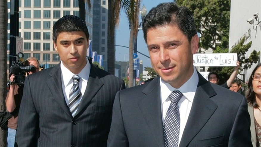 Former California Assembly Speaker Fabian Nunez, right, and his son Esteban Nunez, left, leave a hearing in Superior Court in San Diego