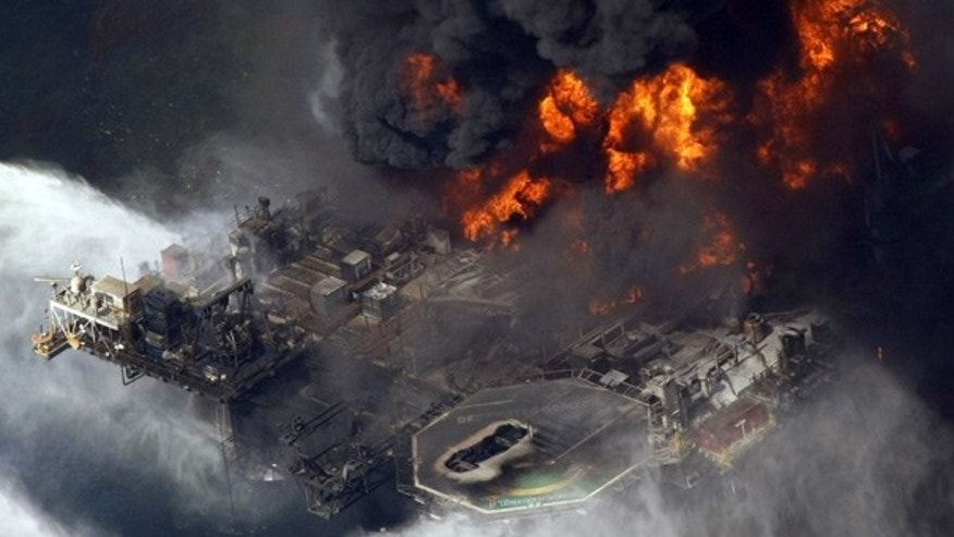 Apr. 21, 2010: The Deepwater Horizon oil rig is seen burning in the Gulf of Mexico.