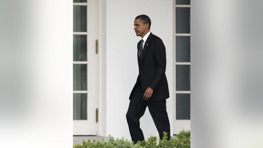President Barack Obama walks to the Oval Office of the White House, Wednesday, March 23, 2011, in Washington, as he returns from Latin America with his family. (AP Photo/Carolyn Kaster)