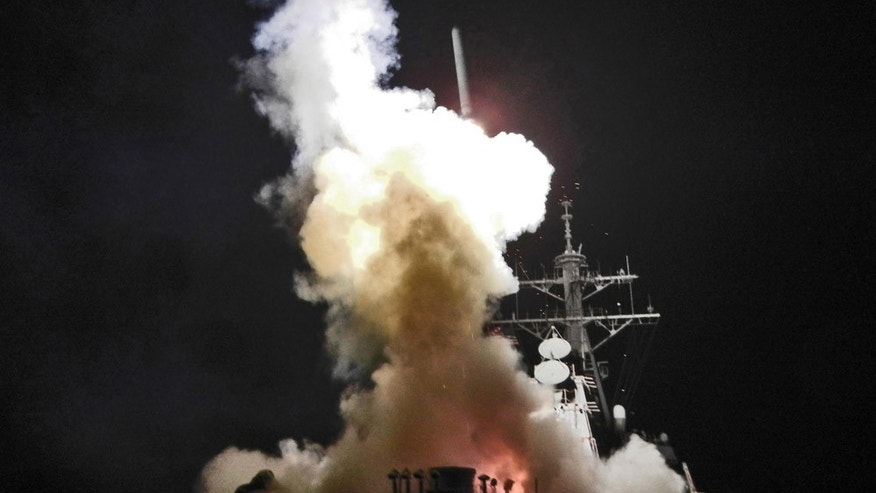 March 19: Arleigh Burke-class guided-missile destroyer USS Barry launches a Tomahawk missile in support of Operation Odyssey Dawn. This was one of approximately 110 cruise missiles fired from U.S. and British ships and submarines that targeted about 20 radar and anti-aircraft sites along Libya's Mediterranean coast. (U.S. Navy)
