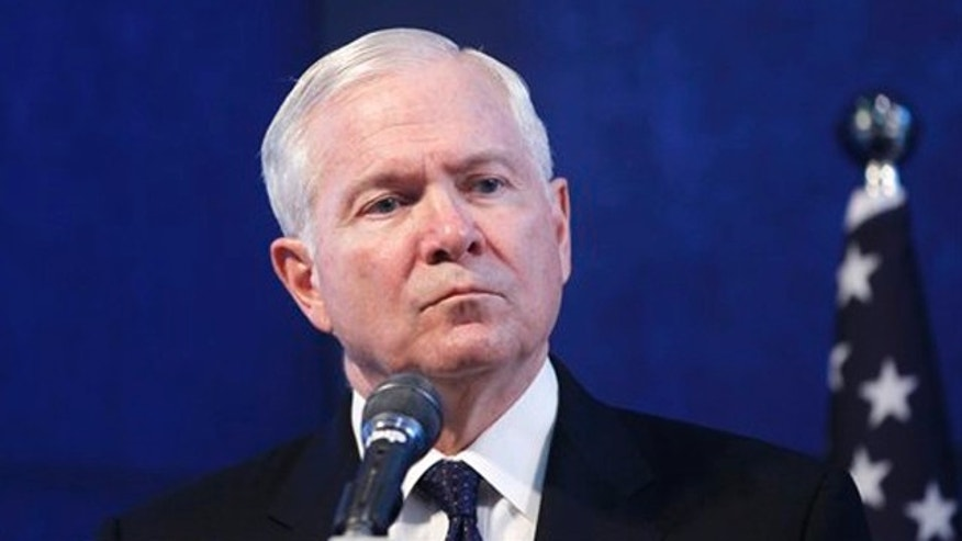 Defense Secretary Robert Gates listens during a joint news conference with Israel's Defense Minister Ehud Barak, not pictured, in Tel Aviv, Israel, March 24.