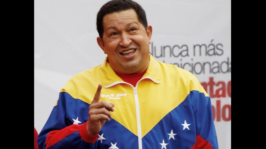 Venezuela's President Hugo Chavez gestures before delivering a speech to supporters Sunday, Feb. 27, 2011, Chavez scoffed at opponents'' suggestions that the protests sweeping the Middle East could occur in Venezuela and vowed not to allow violent uprisings aimed at spurring his ouster, prompting applause from a crowd of red-clad supporters. (AP Photo/Fernando Llano)