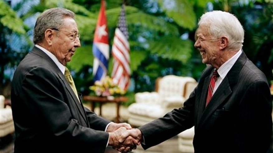 Cuba's President Raul Castro, left, greets former President Jimmy Carter at Revolution Palace in Havana, Cuba, Tuesday March 29, 2011. Carter arrived Monday with his wife Rosalynn for a three-day stay on the island. Carter also visited Cuba in 2002, and is the only former U.S. president to do so since the 1959 revolution. (AP Photo/Javier Galeano, Pool)