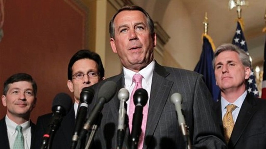 House Speaker John Boehner and other GOP leaders discuss budget negotiations on Capitol Hill in Washington March 29.