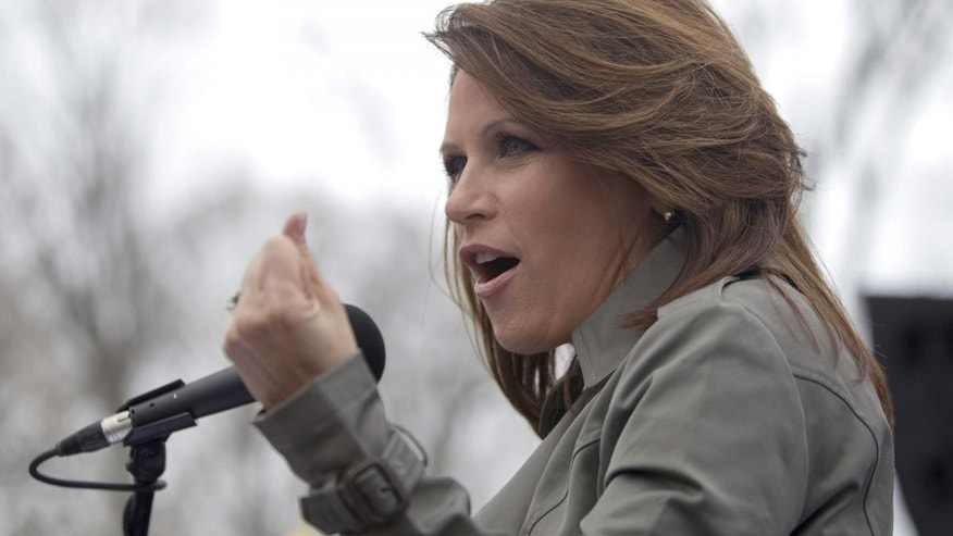 "Rep. Michele Bachmann, R-Minn. gestures while addressing a Tea Party ""Continuing Revolution Rally"" on Capitol Hill in Washington, Thursday, March 31, 2011. (AP Photo/Evan Vucci)"