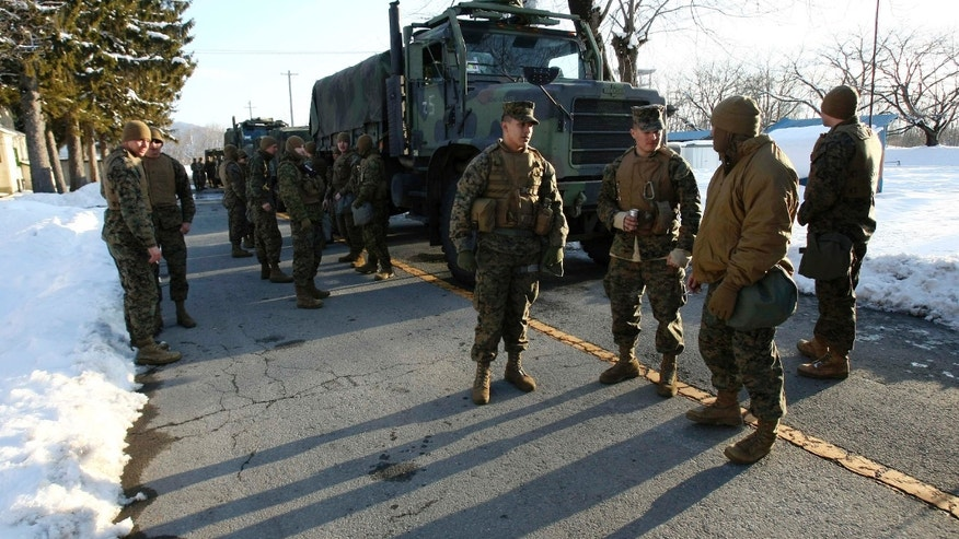 U.S. Marines arrive in a convoy from Camp Fuji, central Japan, at Jinmachi military base to assist relief efforts for quake and tsunami victims, Friday, March 18, 2011, in Yamagata City, Yamagata Prefecture, northeastern Japan.