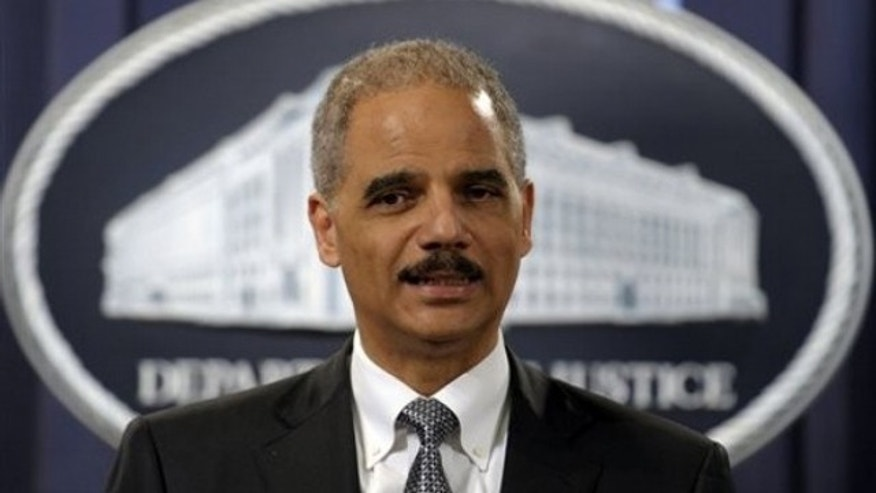 Attorney General Eric Holder speaks during a news conference in Washington March 9.