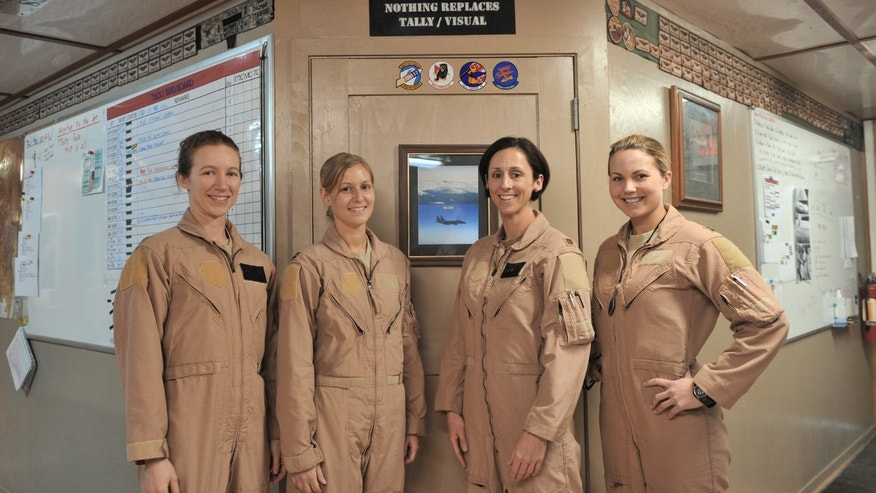 Maj. Tracy Schmidt, Capt. Leigh Larkin, Maj. Christine Mau and Capt. Jennifer Morton pose for the camera before their mission March 29, 2011, at Bagram Airfield, Afghanistan. Schmidt is a 389gh Expeditionary Fighter Squadron F-15E Strike Eagle pilot, Larkin is a 389th ESF weapons system officer, Mau is a 455th Expeditionary Wing executive officer and F-15 pilot and Morton is a 389th EFS weapon system officer.