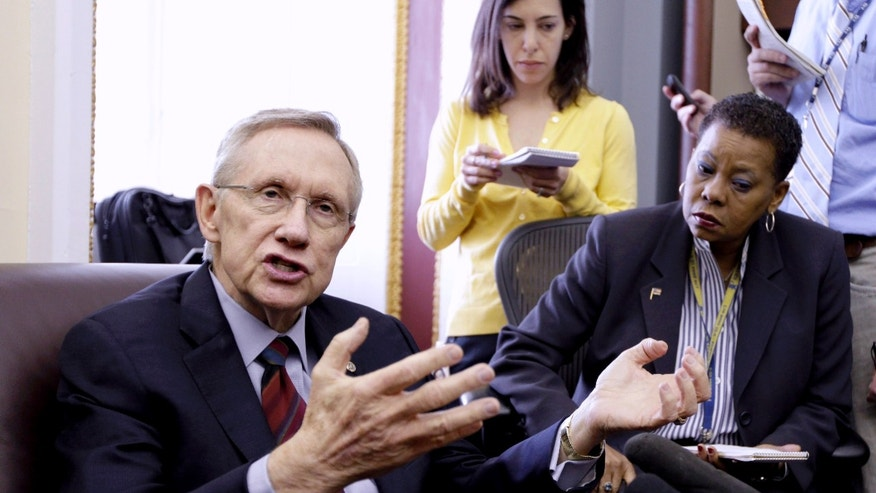 Friday: Senate Majority Leader Harry Reid gestures while speaking with reporters on Capitol Hill on the budget impasse.