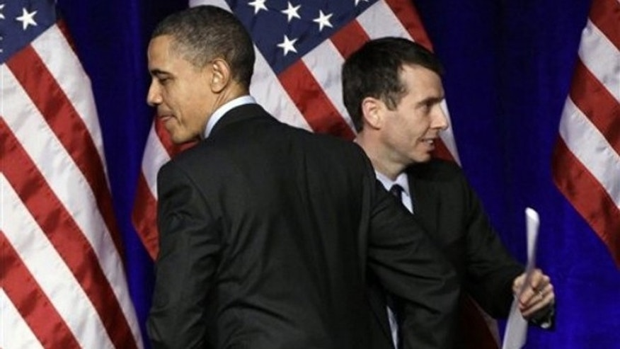 President Obama is introduced by senior adviser David Plouffe before he speaks at a Democratic National Committee event in Washington March 16.