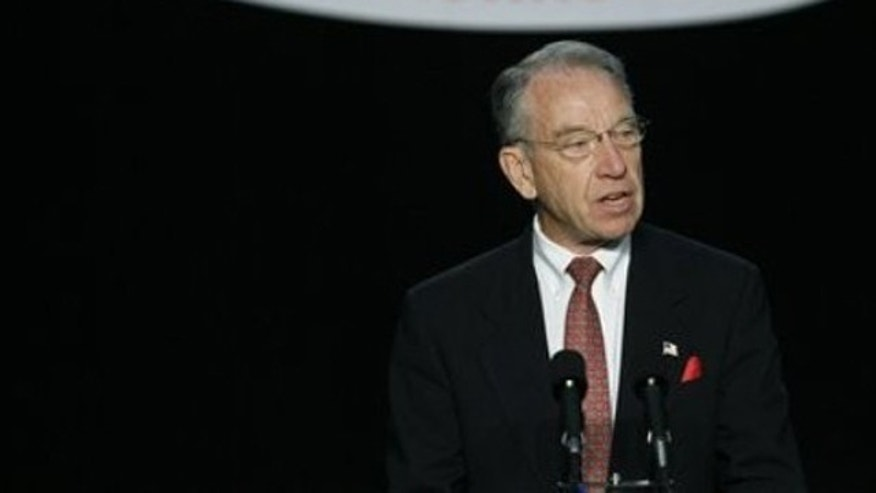 In this June 26, 2010, photo, Sen. Charles Grassley speaks to delegates during the Iowa Republican Party state convention in Des Moines.