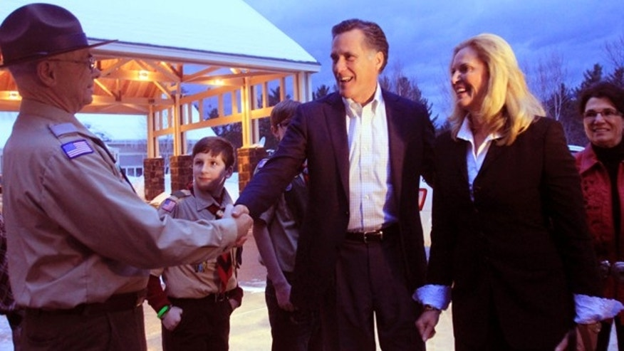 FILE: Former Massachusetts Gov. Mitt Romney and his wife, Ann, are greeted in Bartlett, N.H. on March 5.