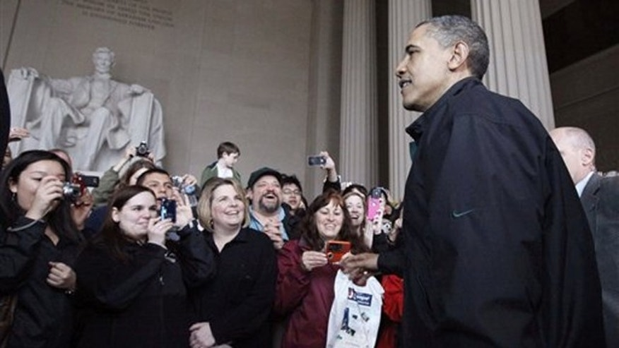 President Obama visits the Lincoln Memorial in Washington April 9.