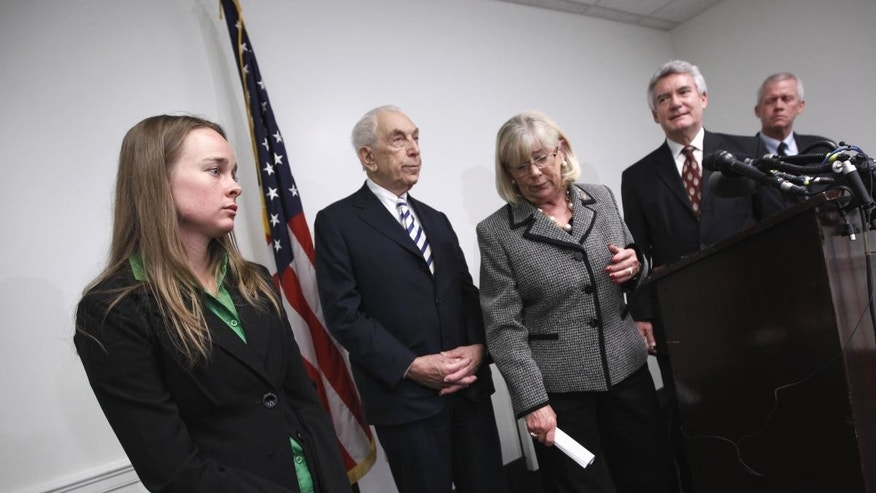 Kelly O'Brien, fiance of Congressional staffer Gabe Zimmerman who was killed in the shooting rampage in Tucson, Ariz., left, attends a news conference on Capitol Hill in Washington, Tuesday, April 12, 2011, to endorse legislation to ban large-capacity ammunition magazines. From left are, O'Brien, Sen. Frank Lautenberg, D-N.J., Rep. Carolyn McCarthy, D-N.Y., Paul Helmke, president of the Brady Campaign, and Ross Zimmerman, father of shooting victim Gabe Zimmerman. (AP Photo/J. Scott Applewhite)