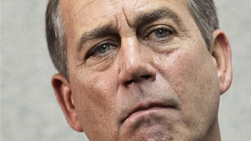 House Speaker John Boehner speaks to reporters on Capitol Hill April 13.