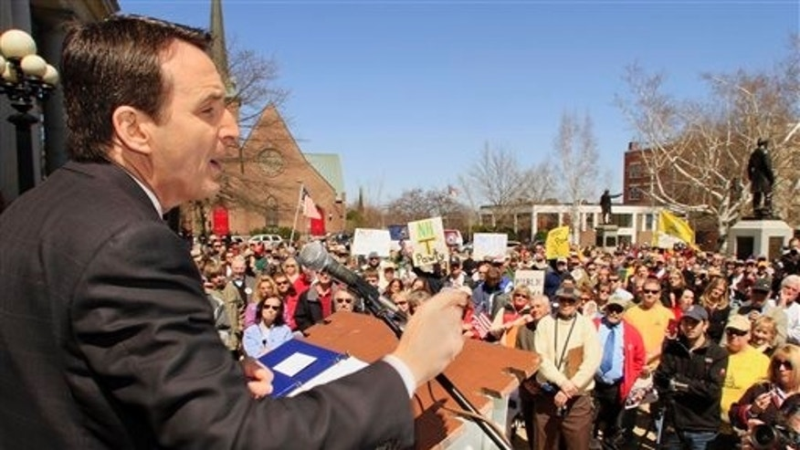 April 15: Former Minnesota Gov. Tim Pawlenty speaks to a crowd at a Tea Party rally at the Statehouse, in Concord, N.H. (AP)