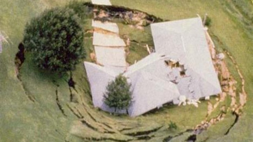 "Shown here is an example of a ""catastrophic ground cover collapse"" sinkhole."