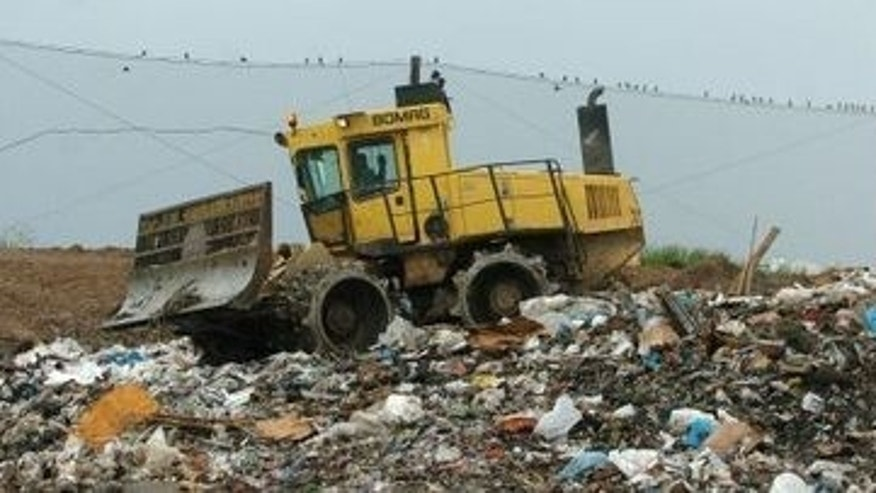 Michigan lawmakers hope to discourage Canadian dump trucks from crossing the border to make use of their landfills, such as the one pictured above in Kent County, by passing legislation imposing fees to bring garbage stateside.