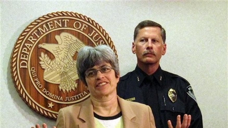 April 22: Karen Loeffler, left, the U.S. Attorney in Alaska and Police Chief Mark Mew address the media at a news conference in Anchorage, Alaska. Authorities say a Mexican national in the U.S. illegally stole another man's identity and became a police officer in Alaska.  Mora Lopez had been employed as an Anchorage police officer since 2005 under the name Rafael Espinoza. (AP)