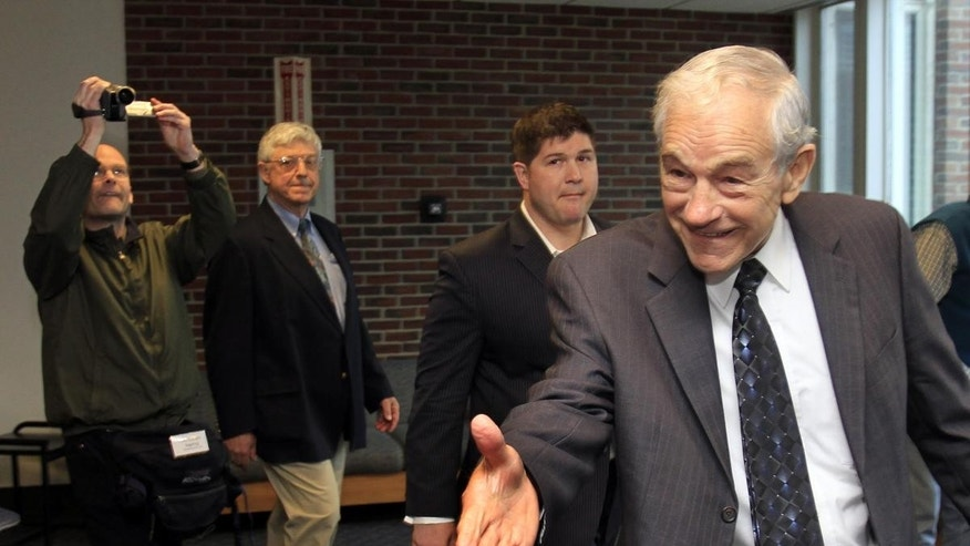 Possible 2012 presidential candidate, U.S. Rep. Ron Paul, R-Texas reaches out to greet students at the University of New Hampshire Thursday, March 24, 2011 in Durham, NH (AP Photo/Jim Cole)