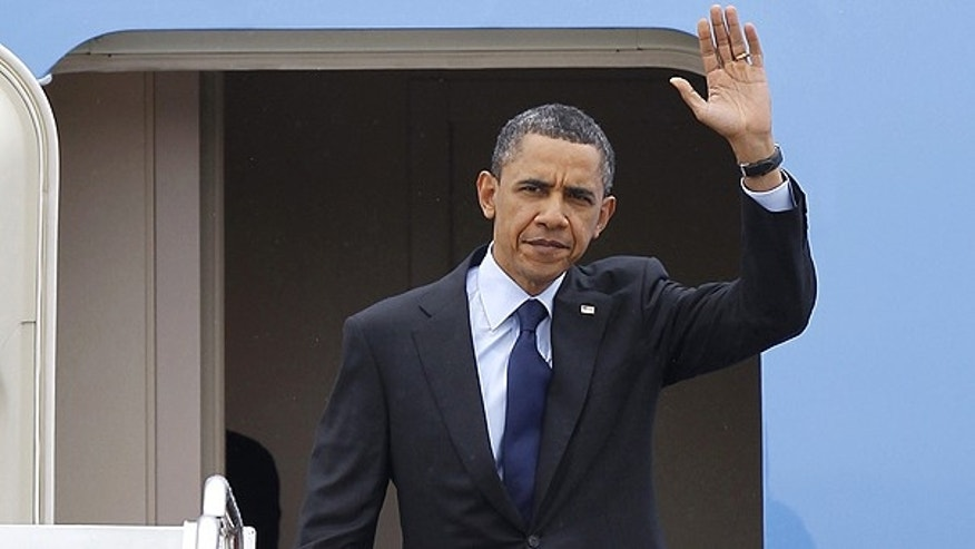 April 22: President Obama waves upon his arrival at Andrews Air Force Base, Md.