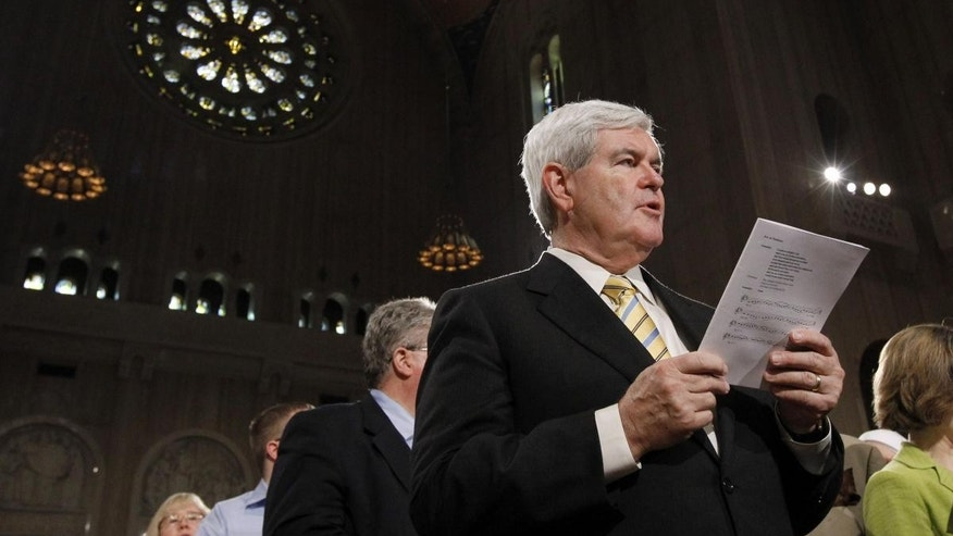 Former Speaker Newt Gingrich sings during Easter Mass at the Basilica of the National Shrine of the Immaculate Conception Roman Catholic Church Sunday, April 24, 2011 in Washington. (AP Photo/Alex Brandon)