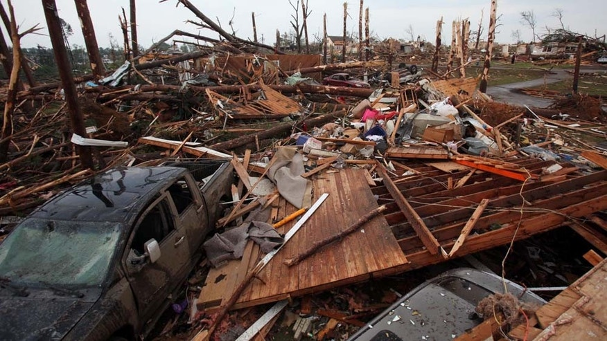 The Forest Lake neighborhood is completely destroyed in Tuscaloosa, Ala. Wednesday, April 27, 2011. A wave of severe storms laced with tornadoes strafed the South on Wednesday, killing at least 16 people around the region and splintering buildings across swaths of an Alabama university town. (AP Photo/The Tuscaloosa News, Dusty Compton)