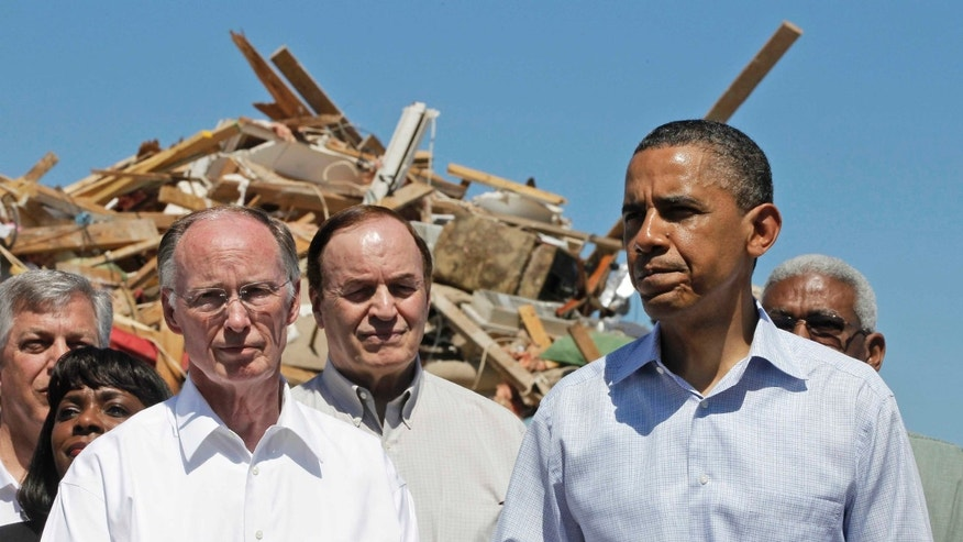 President Obama stands with Alabama Gov. Robert Bentley, left, Sen. Richard Shelby, R-Ala., and others, as they toured tornado damage in Tuscaloosa, Ala., Friday, April 29, 2011. (AP)
