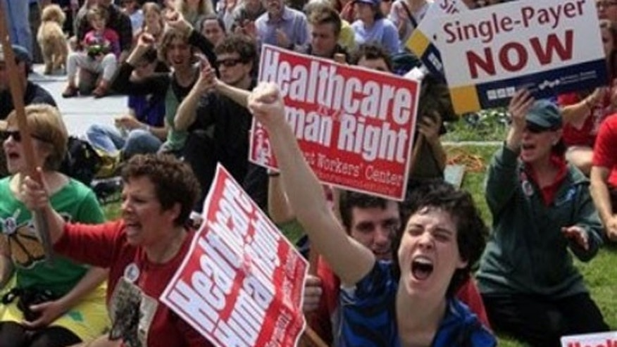 Kelly McNayr, center, of Burlington, Vt. , shouts with the crowd during a health care rally Saturday, May 1, 2010, at the statehouse in Montpelier, Vt. , where several hundred single-payer health care system supporters gathered believing that the federal bill didn't go far enough. (AP)